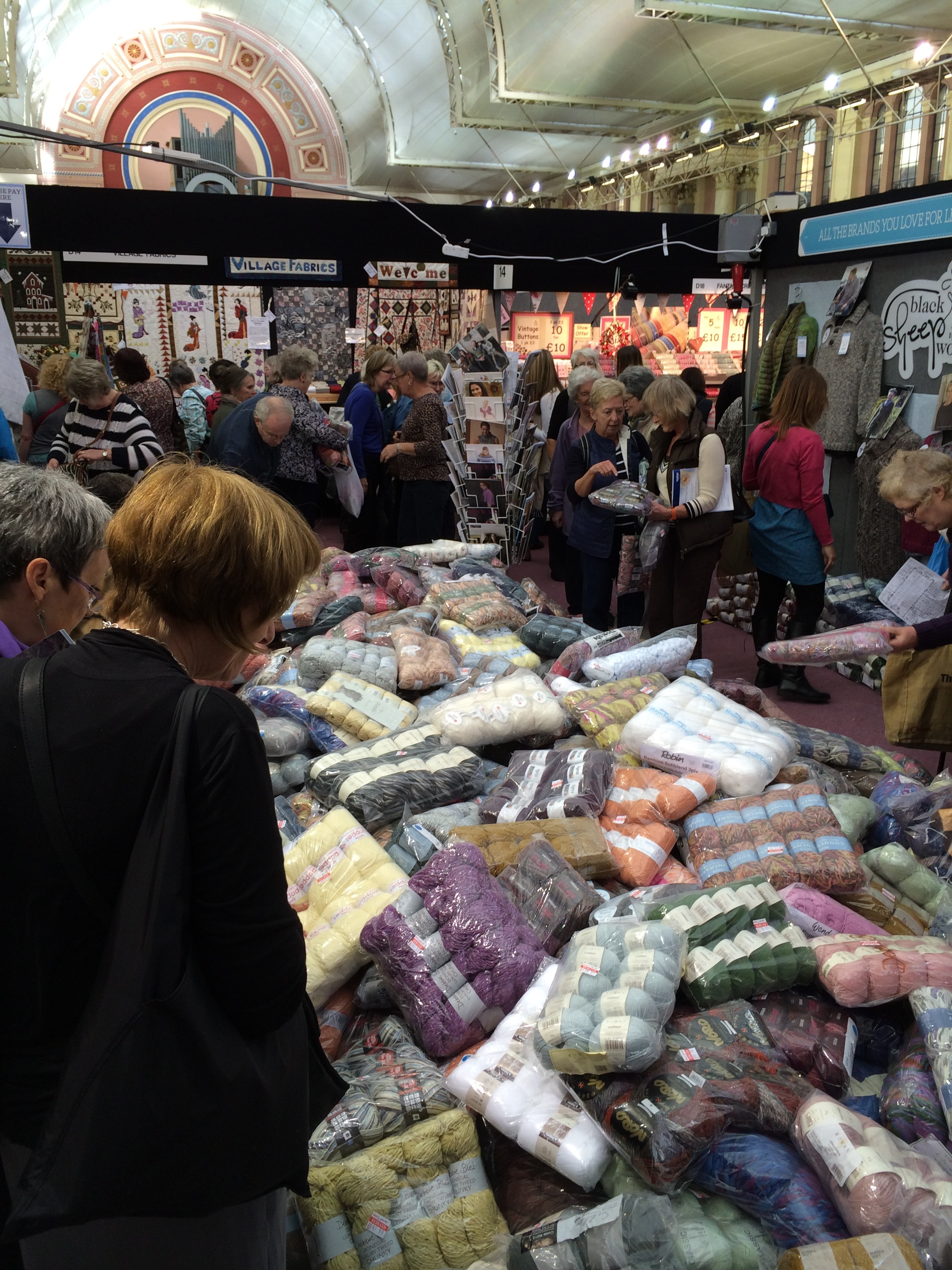 "An example of the commercial side of the show - many shoppers come hunting for bargains and Black Sheep Wools has become known for it's ""pile o' yarn""!"