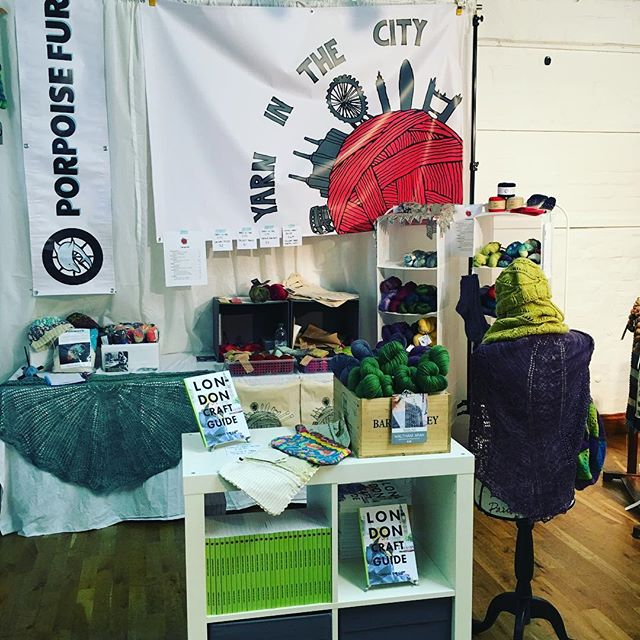 Our booth on Sunday morning at Unravel, somewhat depleted of yarn.