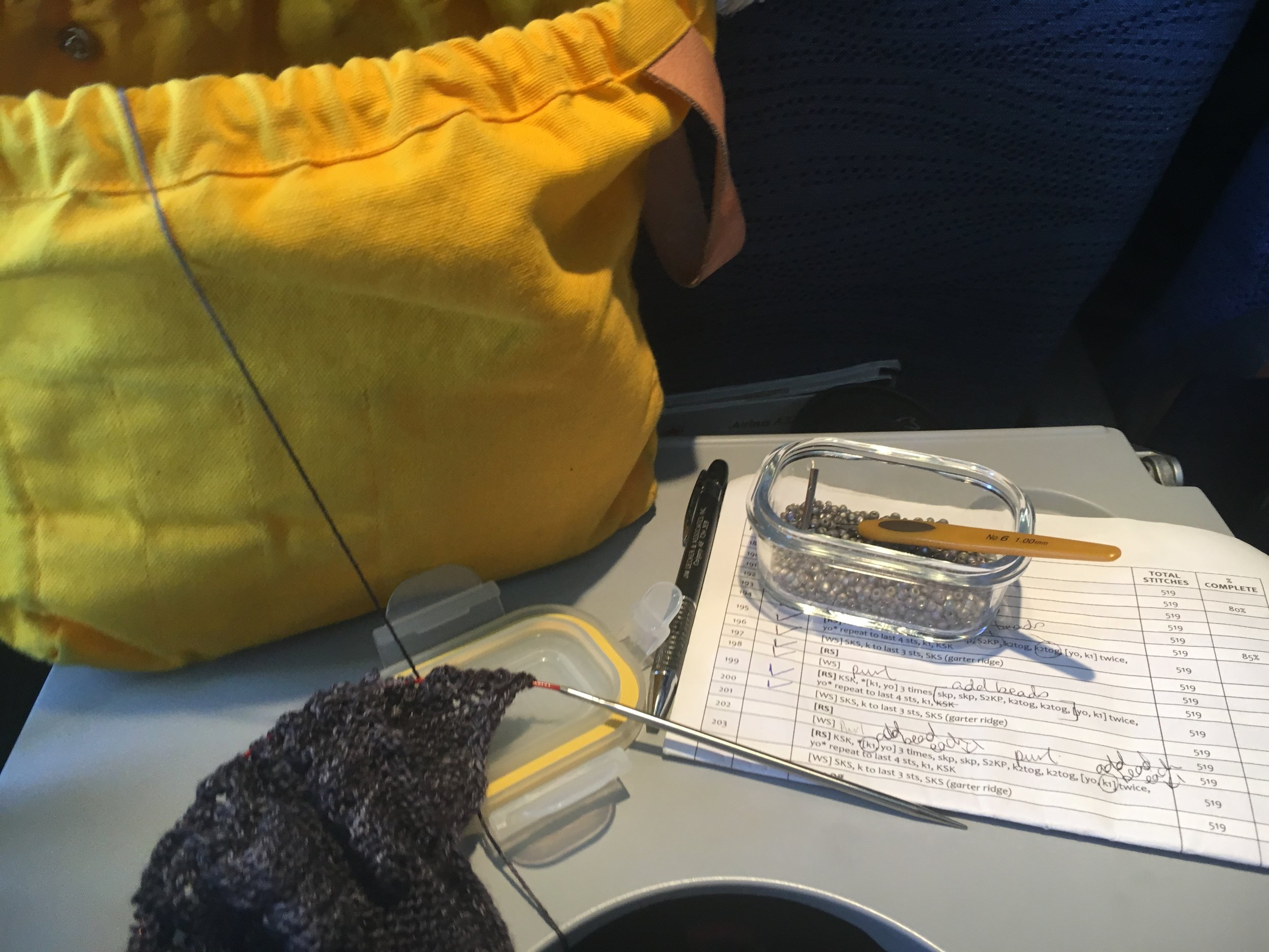 Bead knitting on a plane!