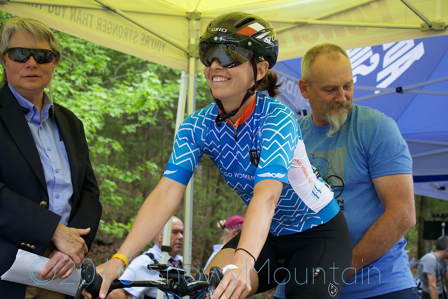 Nicole Mertz  shares a joke with the starting officials.Photo by SnowyMountain Photography.