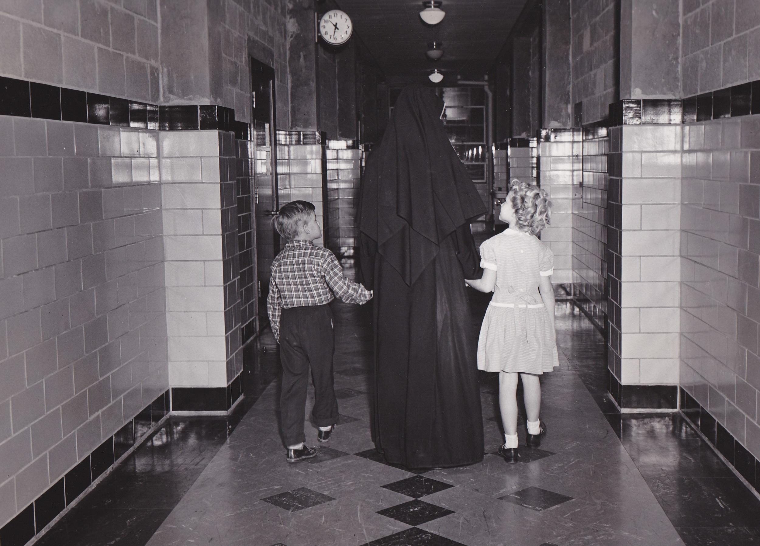10-Sr and Kids Hallway 1950s.jpg