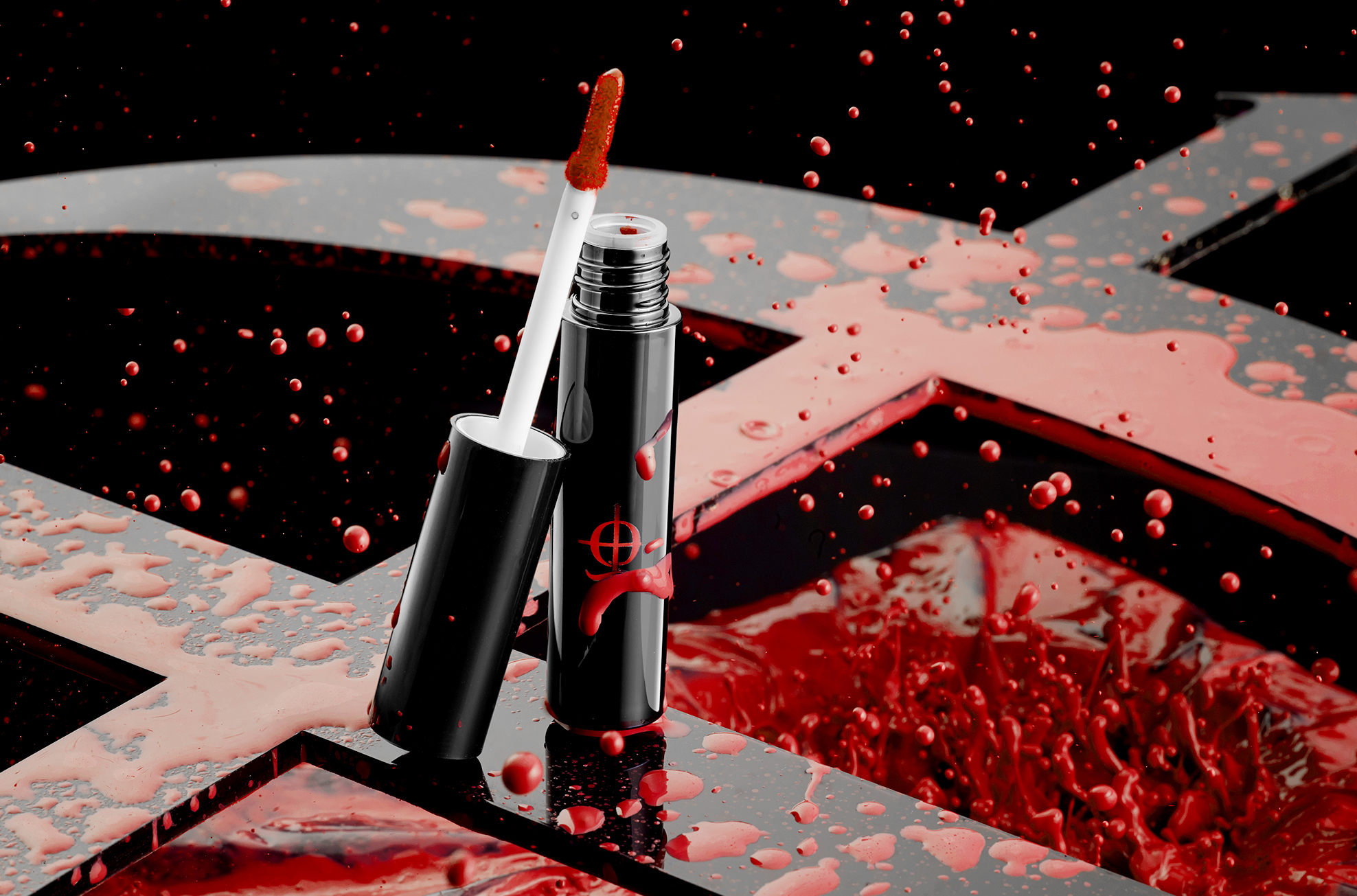 london product photographer  chris howlett A creative advertising product photography containing cosmetic products surrounded by explosion of red paint