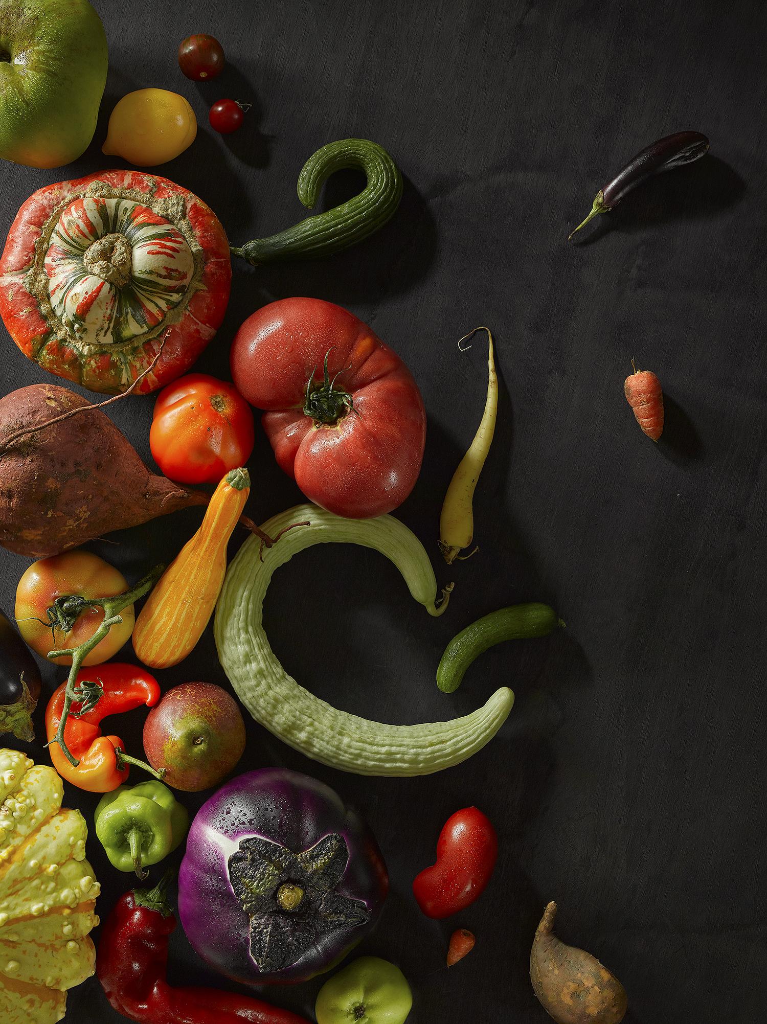 Still Life food photography. Mixed raw foods, fruit and veg on dark wood, autumnal feeling, food and lifestyle photography, London & Croydon food studio.