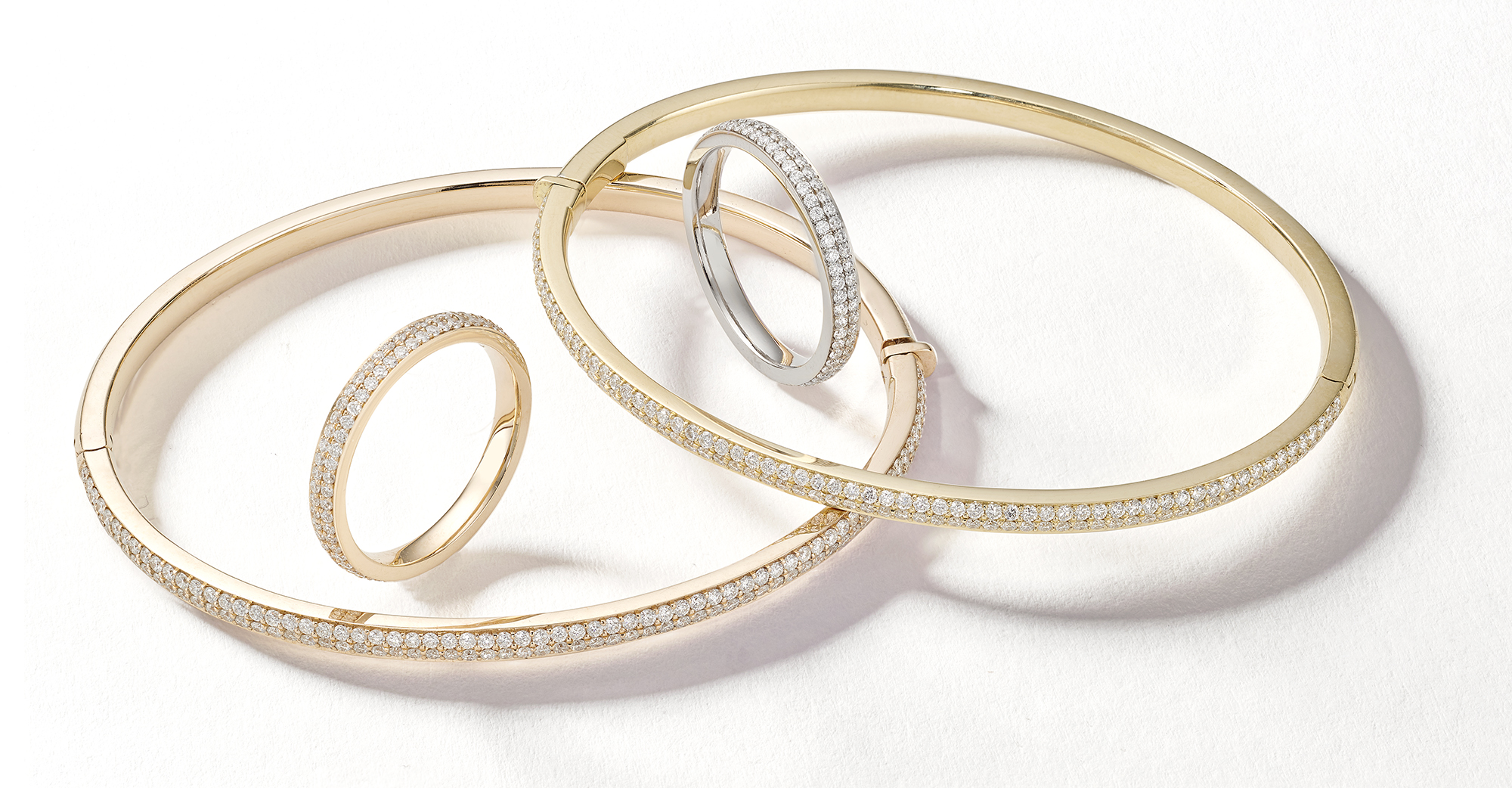 Jewellery photography London, diamond bangles and gold and silver rings create this creative packshot from still life jewellery photographer Howlett Photography