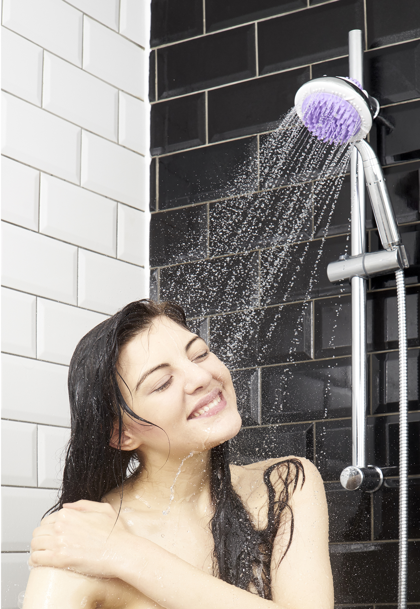 Lifestyle packshot photography, a model in shower with product in bathroom setting, Advertising lifestyle product packshot