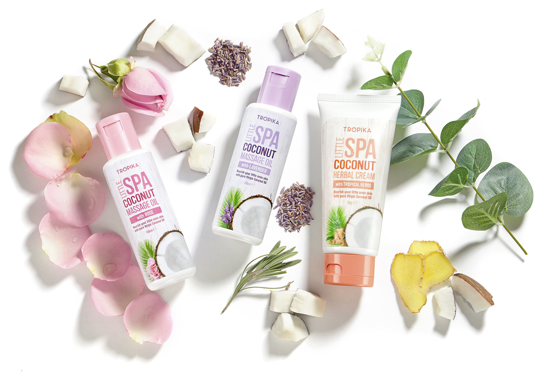 Product packshot of beauty products on a white background, ingredients placed around the cosmetic products with strong bold shadows, A London creative lifestyle photographer