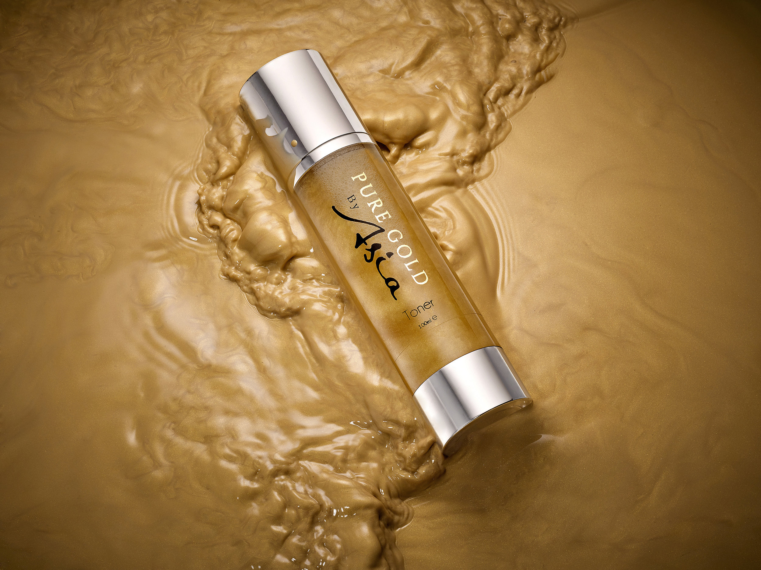 creative still life photography of liquid gold cosmetics created by London product photographer howlett photography