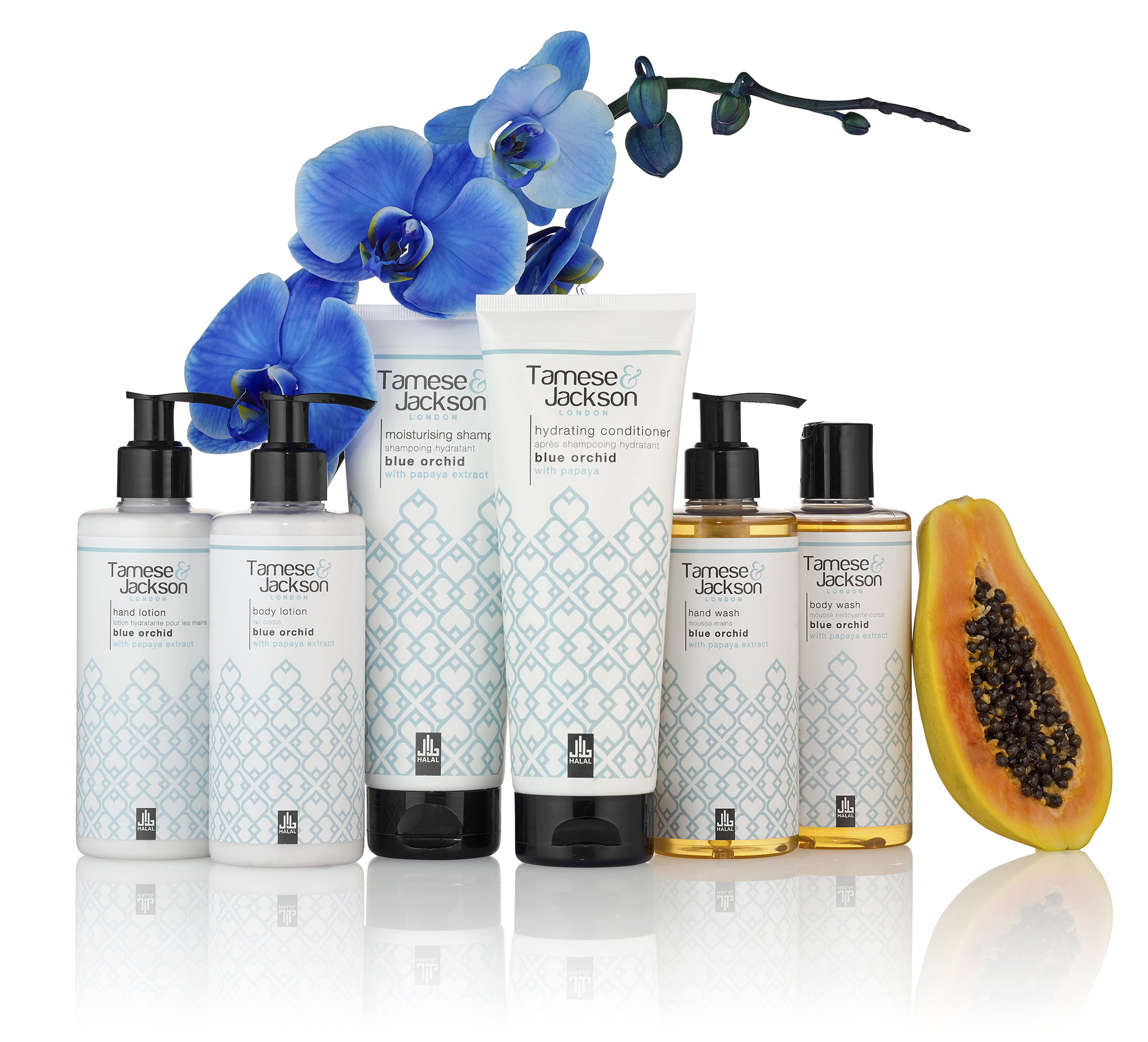 Cosmetic packshot photography with fresh ingredients including orchid and papaya fruit. Still life product photography for cosmetic beauty products.