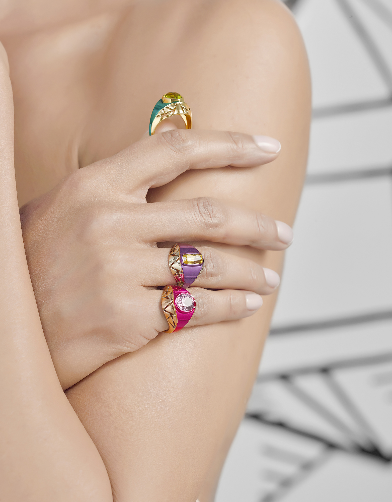 Model wearing jewellery from howlett photography, Rings on hand on arm. Colour gem stone rings from creative still life photographer chris howlett