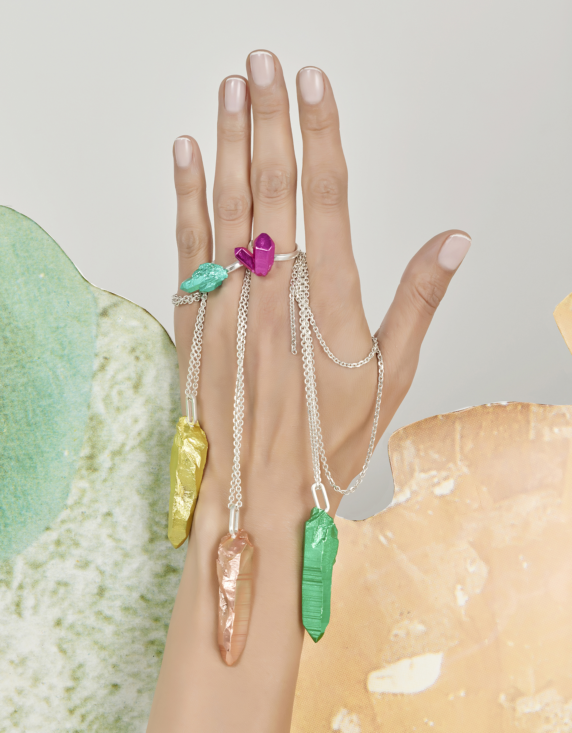 Jewellery on Hands, pendants and rings on model hand with creative still life backgrounds shot in london studio