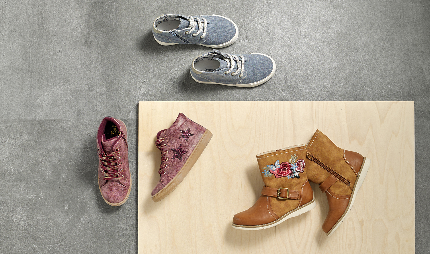 Overhead product packshot photography, kid shoes shot on concrete overhead in london studio howlett photography