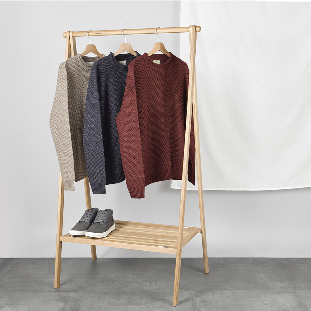 Product packshot photography, clothes on rail in lifestyle setting shot in london studio