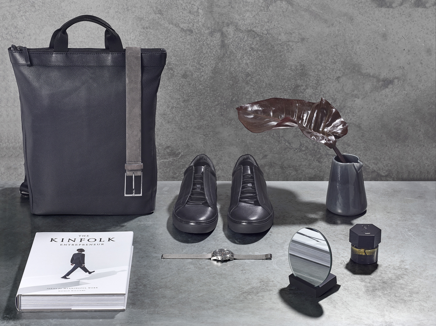 Mens accessories creative still life product photography. Product photographer Chris Howlett creates still life composition using products found at shipping centre. carefully composed products with distinctive studio lighting, created in London