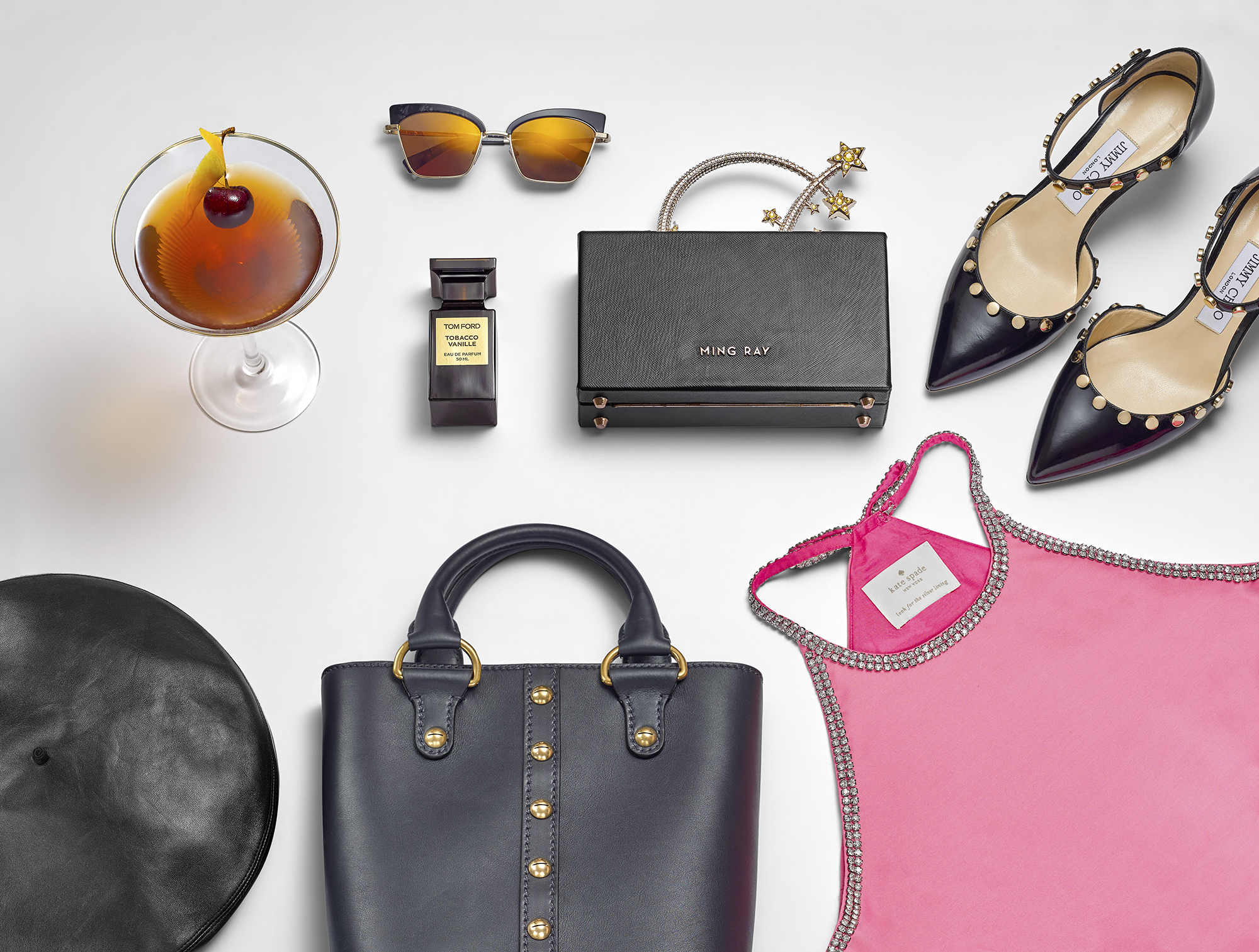 still life fashion accessories from New York. All the products, handbags jewellery dresses and shoes you would need on a city break. Product packshot photography completed by London still life photographer chris howlett