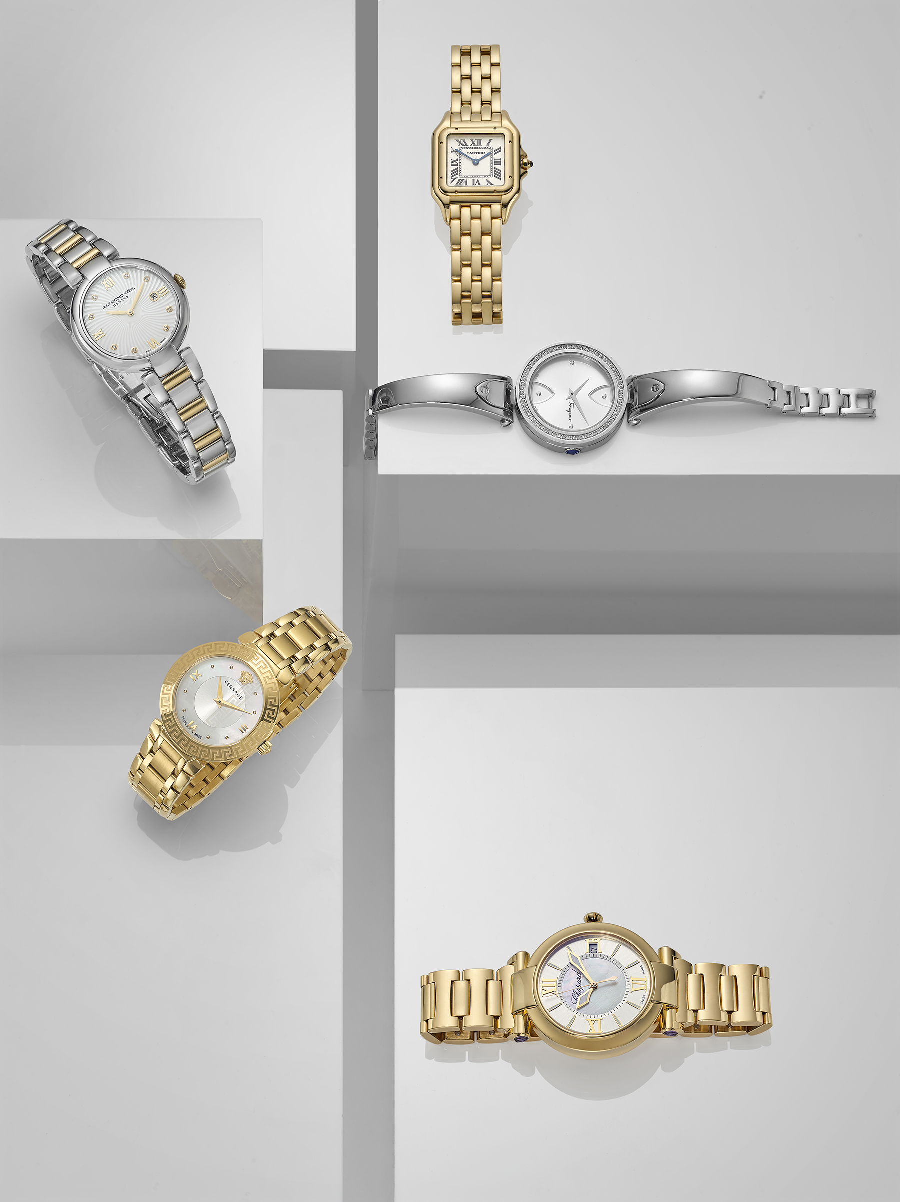 Jewellery photography in london by Chris Howlett. Selection of gold watches placed on glossy white neutral background. Advertising style product photography shot in London photo studio