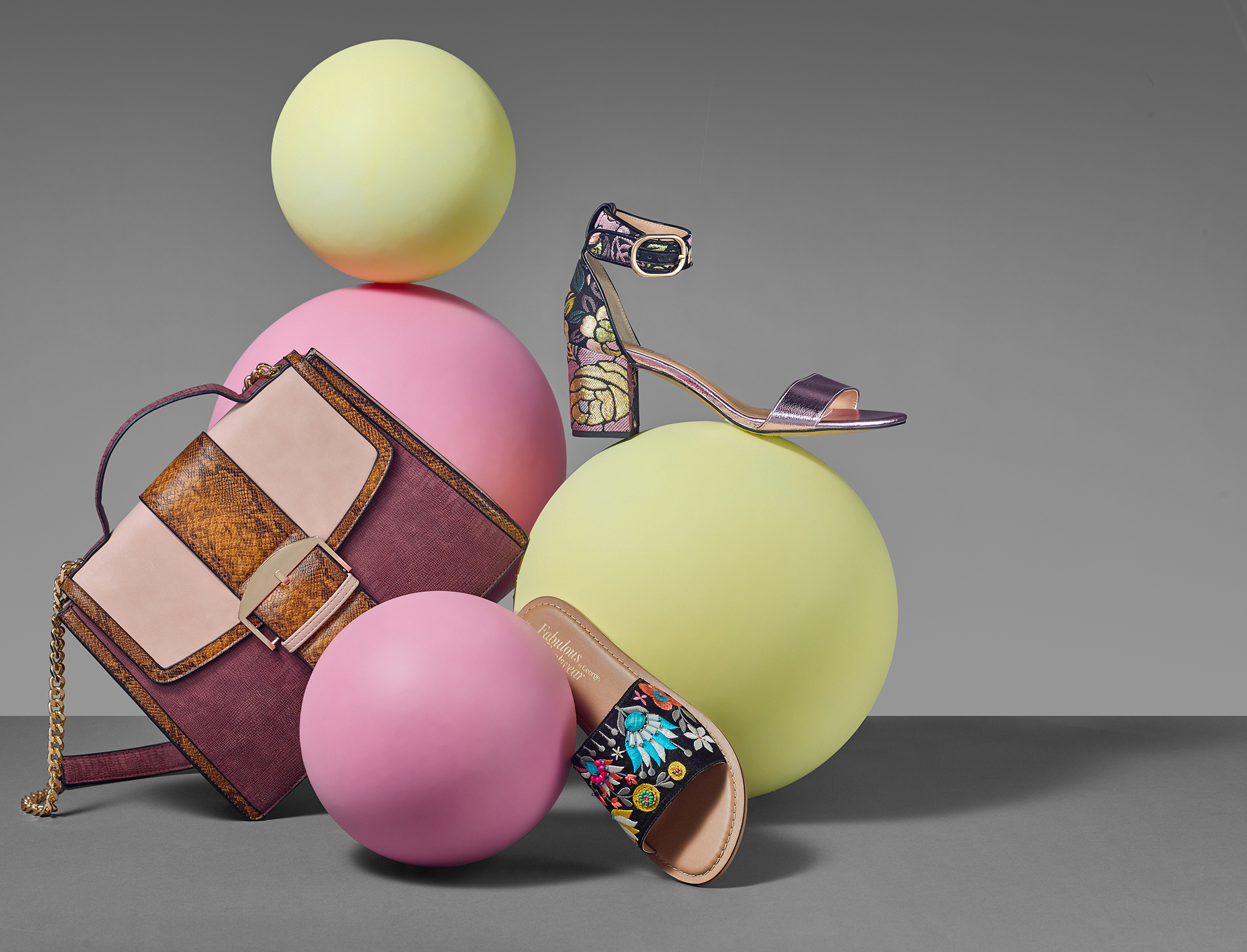 Fashion still life, Women's accessories, hand bags and shoes on spherical coloured shapes. Creative product and packshot photography for commercial advertising campaigns in London.