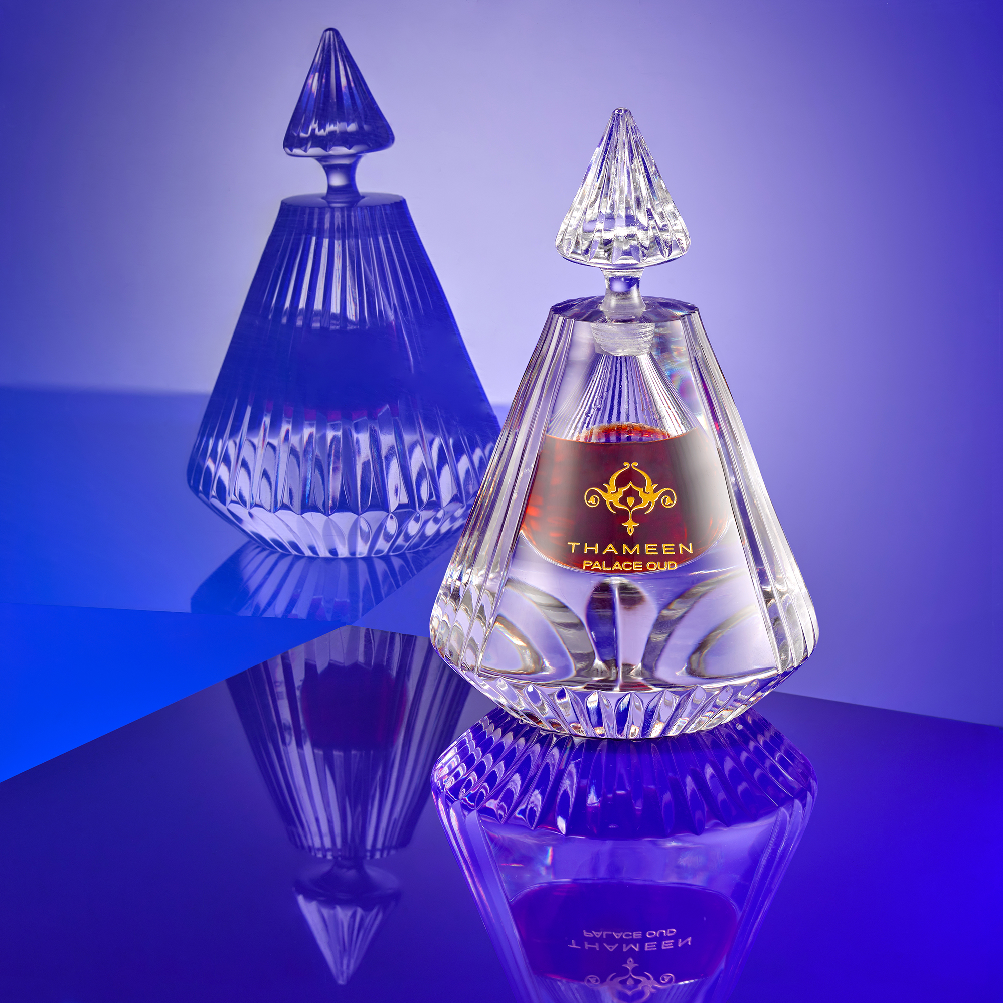 perfumes and cosmetic still life photographer Chris Howlett. Luxury crystal bottle on reflective creative background. Product photography London