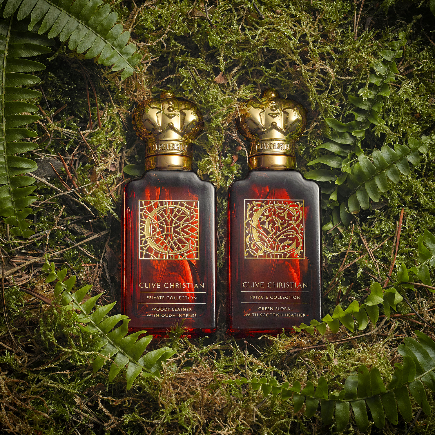 A pair of perfume bottles on moss and grass create this cosmetic still life photograph from london product photographer chris howlett