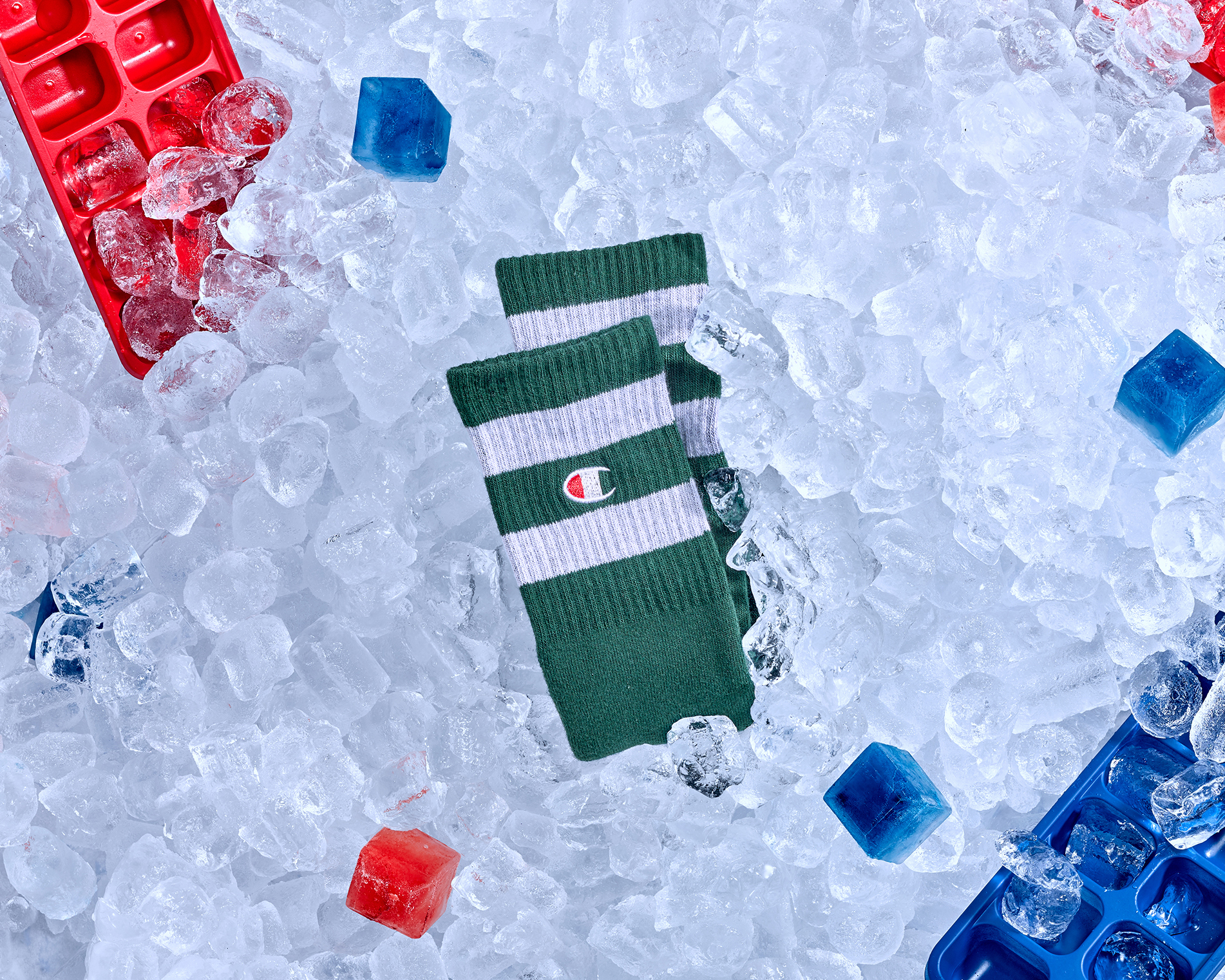 mens fashion accessories green stripy socks surrounded by ice, shot in a creative product packshot style created in london studios by chris howlett