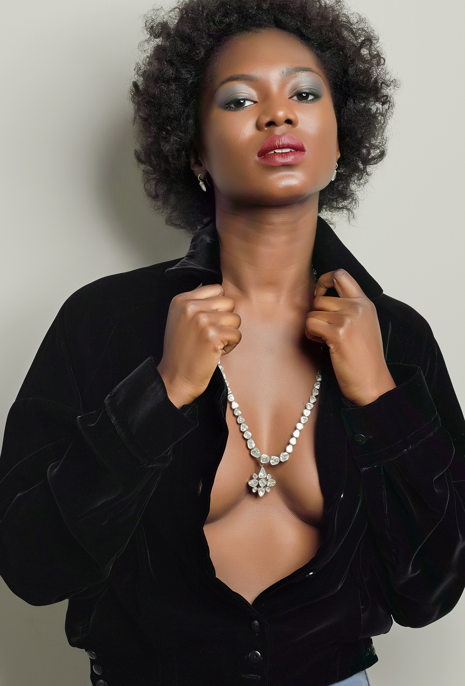 powerful strong pose by model wearing jewellery statement diamond necklace beautiful lighting shot in london location by howlett photography