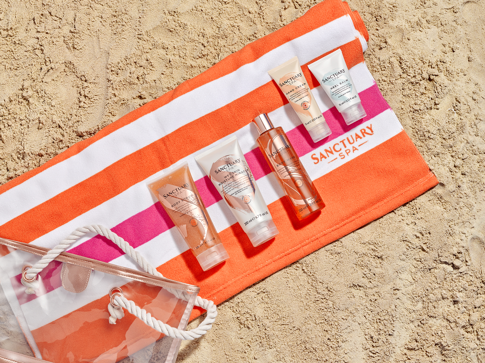 second image taken from a summer beach theme, Cosmetic products on towel and surrounded by sand.