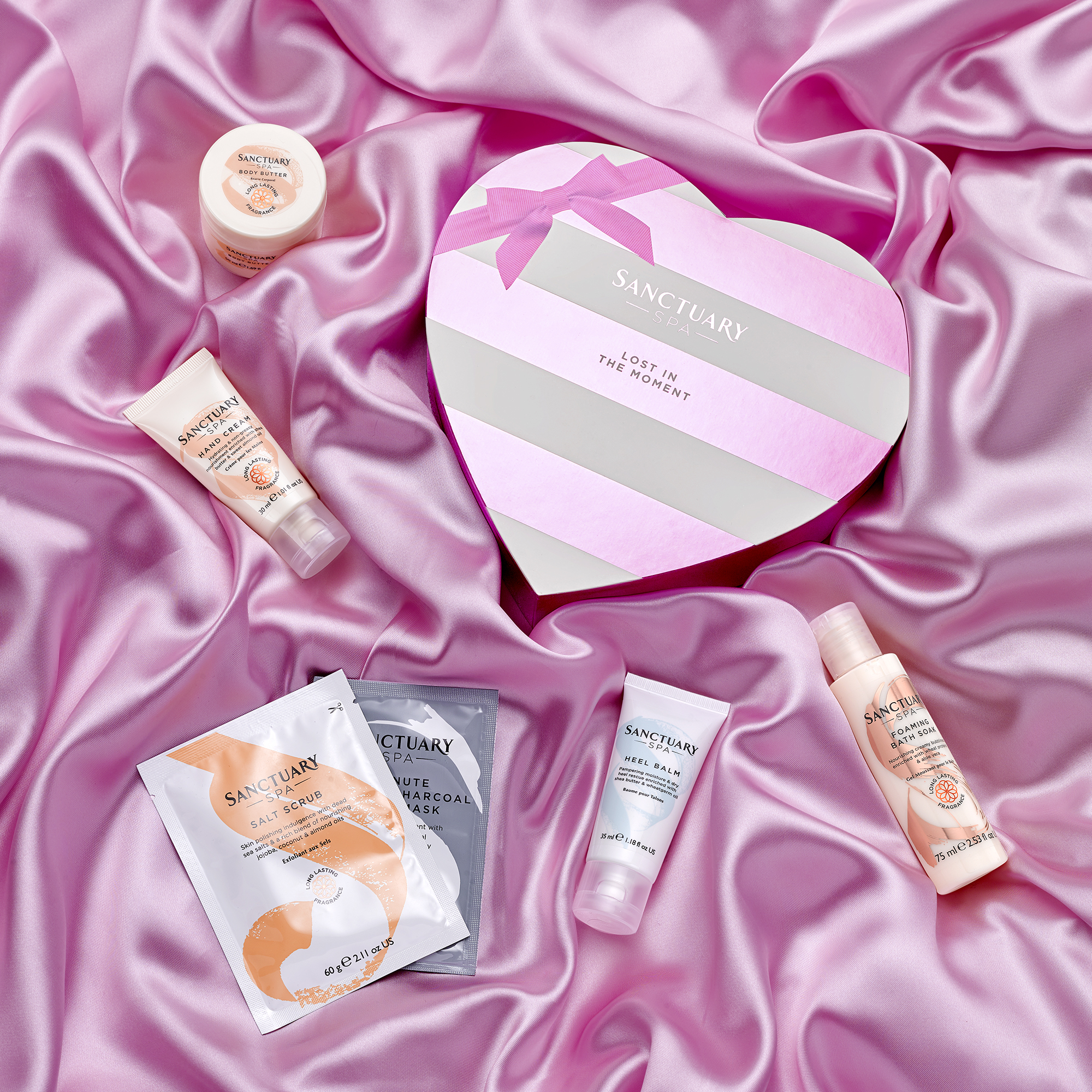 mothers day beauty products on soft silk, creative still life photography from london