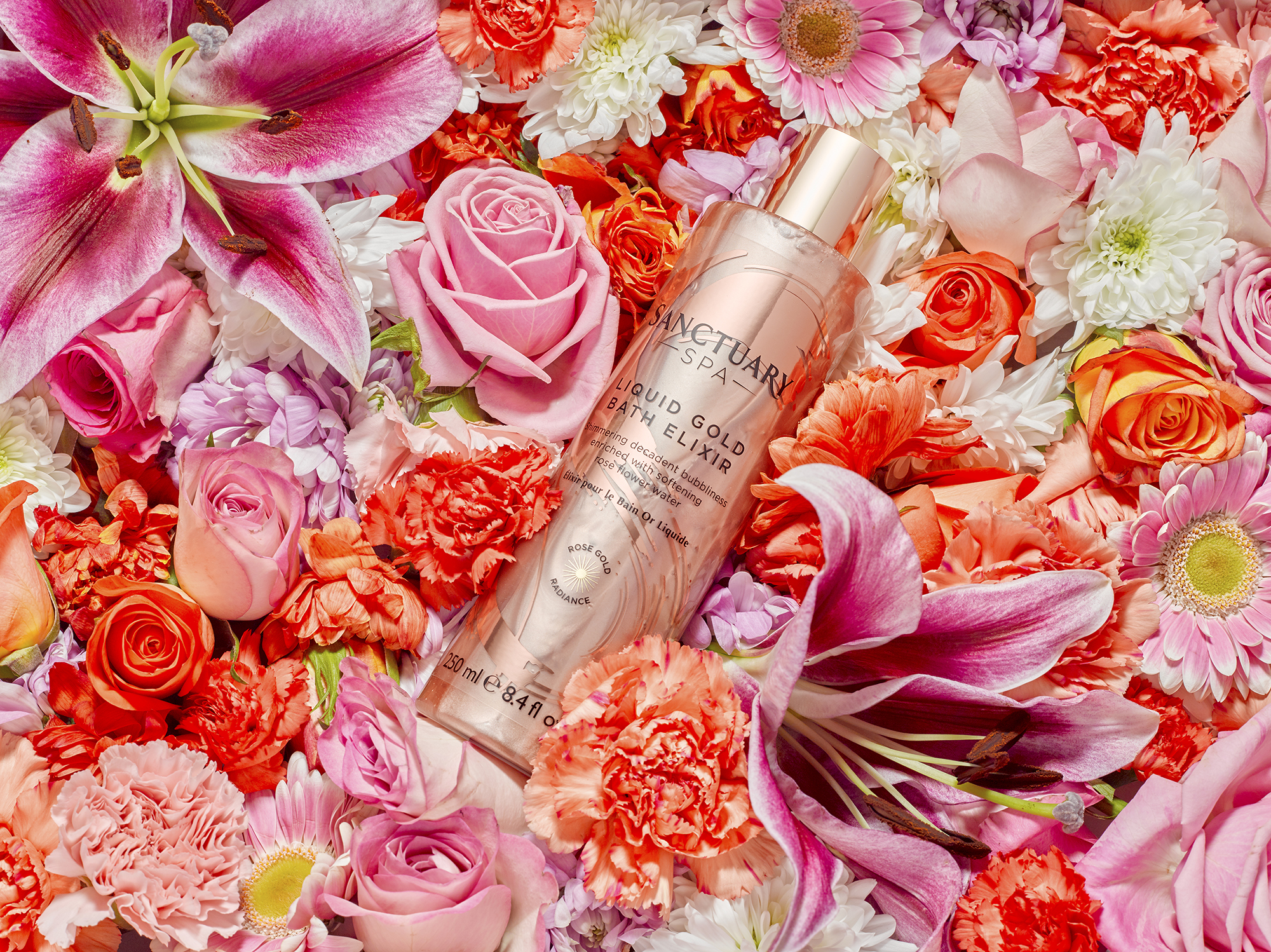 beauty product surround by fresh flowers from london photographer chris howlett