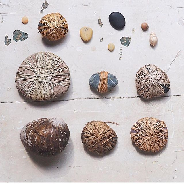 We love the way that @petalplum wraps stones and found organic forms with leftover #naturaldye #threads ... such a beautiful language of #tones and useful #tools, too ➰