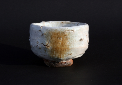 Tea bowl with heavy grit: wood-fired; beech ash 'nuka' glaze with incident oak ash run.