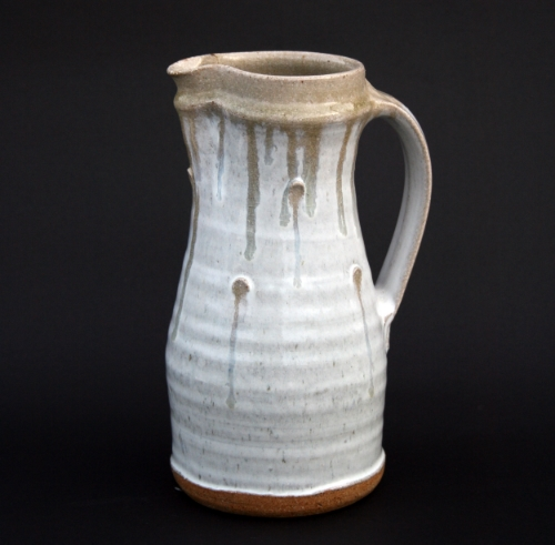 "Jug with pressed pellets, 10 1/2"": beech ash 'nuka' glaze with holly ash rim and holly ash runs."