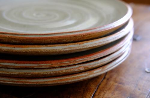 """Five plates, 12"""" dia: white slip; 'eggshell' beach ash glaze."""