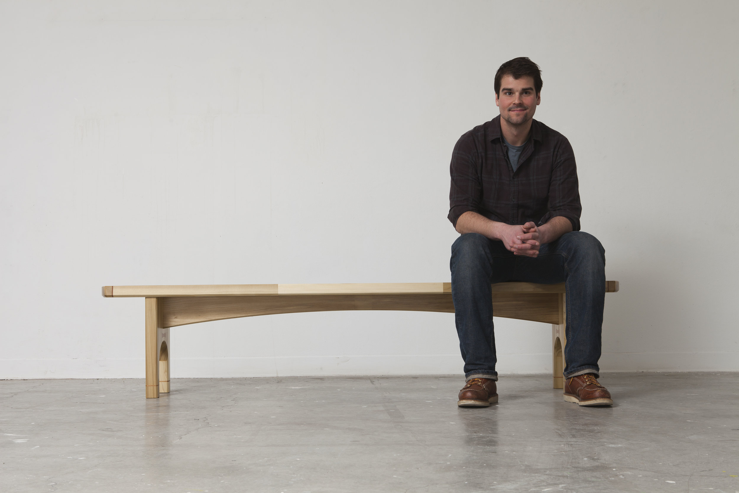 """I'm Mahlon, the Principal designer and chief workman here at Mahlon Huston Projects. - My objective is to design and produce well-engineered, highly crafted furniture that is poised and unencumbered. The methodology in my studio practice is to design each piece with the use of computer-aided drafting, while utilizing traditional woodworking methods in conjunction with manual labor for the production of each piece.The stylistic details found within my work, including accents of exposed joinery, sweeping and dramatic linear edges and taught surfaces. Convey the visual energy existing between hard and soft contours, and intentional color choices, all serve to bring levity to each individual work.These markers grow from my captivation with the formal characteristics found in mid- 20thcentury furniture, and from the cubist movement. Through my interpretations of these inspired forms, I am able to portray my own style of contemporary design thus creating a space """"where craft styles elegance""""."""
