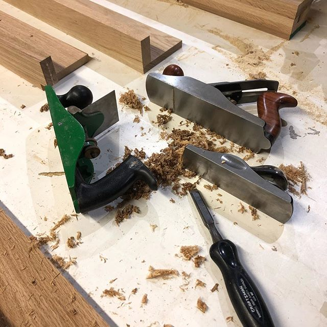 Hand working some white oak landing tread today with my scraper plane, smoothing plane, low angle block plane and 1/2 chisel.  I'm at the bench living my best life. . . . What's up Cincinnati! It's been a busy few weeks with a ton of change. I moved myself and my shop from upstate New York to Cincinnati and took up a job as a finish carpenter with @cincinnatistair.  I just installed my table saw and outfeed in the shop. It's going to be a huge improvement to work flow and safety. I will be designing and building spec furniture in the coming weeks and am always looking for the next commission.  If anyone is in the Cincinnati area and wants to grab a beer and talk furniture let me know! . . . #cincinnati #ohio  #furnituremaker #furniture #moderndesign #modernfurniture #modern #contemporaryartist #contemporyfurniture #contemporarydesign #art #woodworking #woodworker #interiorarchitecture #designer #woodworkerofinsta #design #interiordesign #joints #industrialdesign #madeinamerica #madeinohio #hustle #craft #contemporarycraft  #sculpture #cincinnatistairs