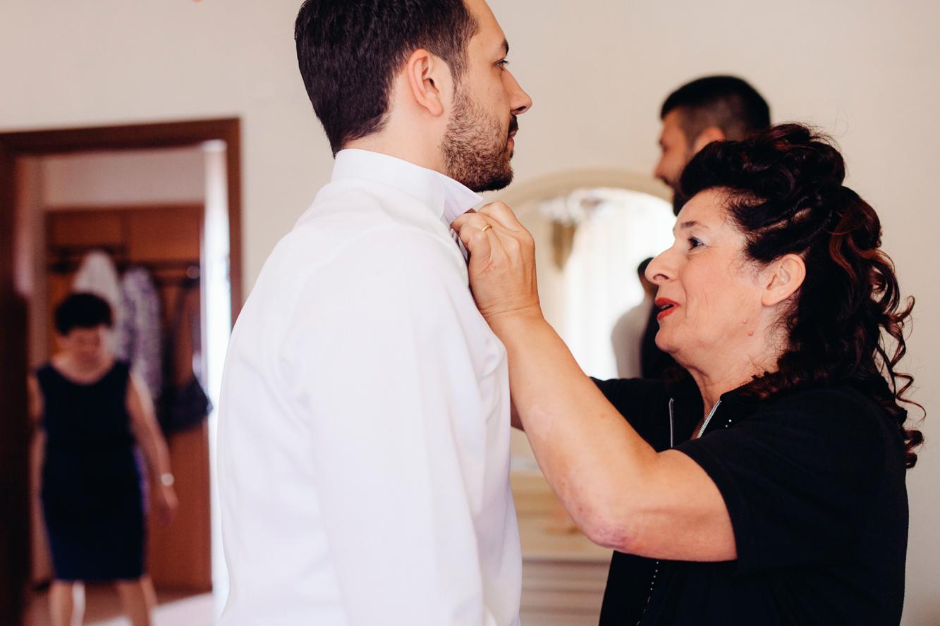 033-groom getting ready.jpg