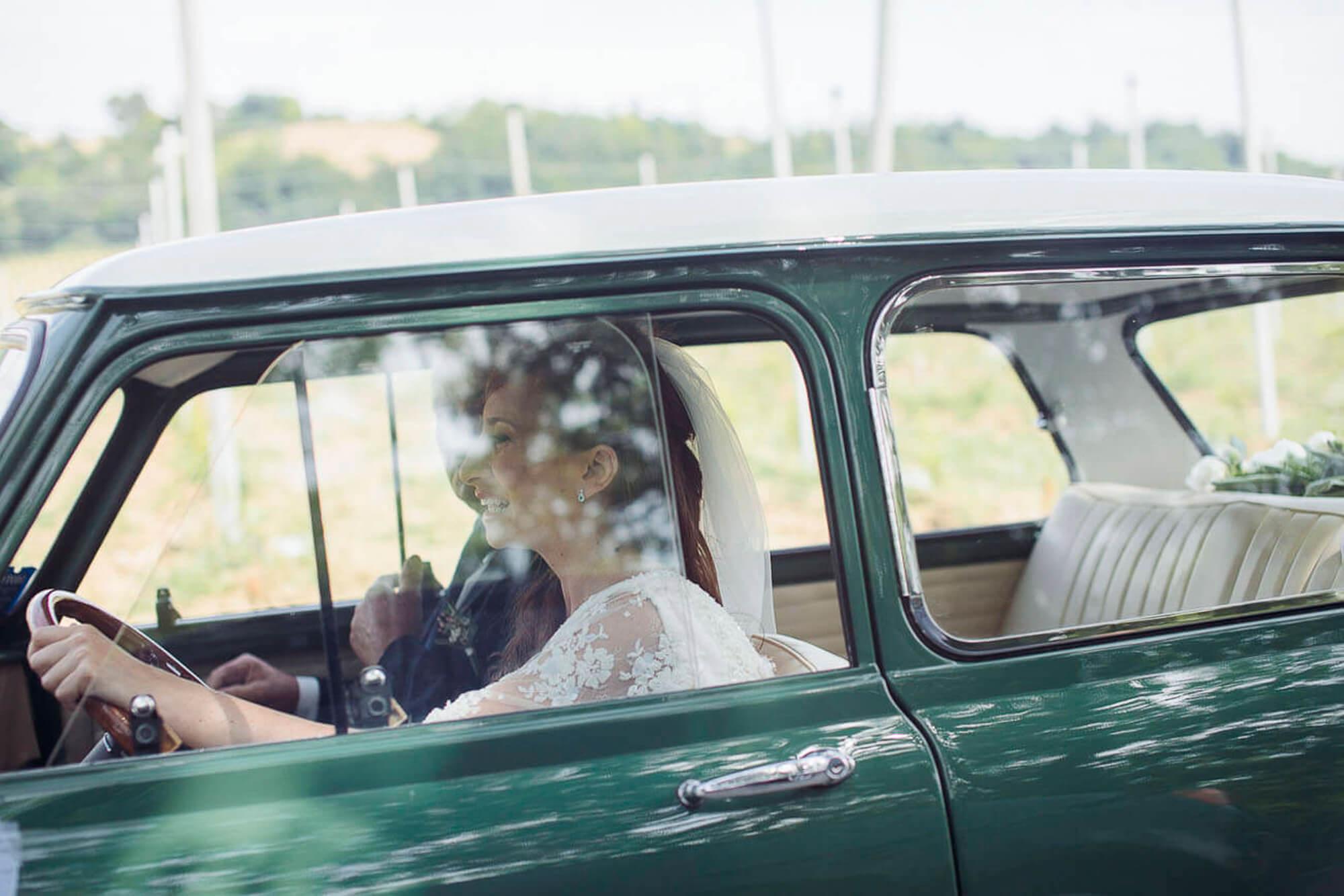 52_wedding_marche_bride driving car.jpg