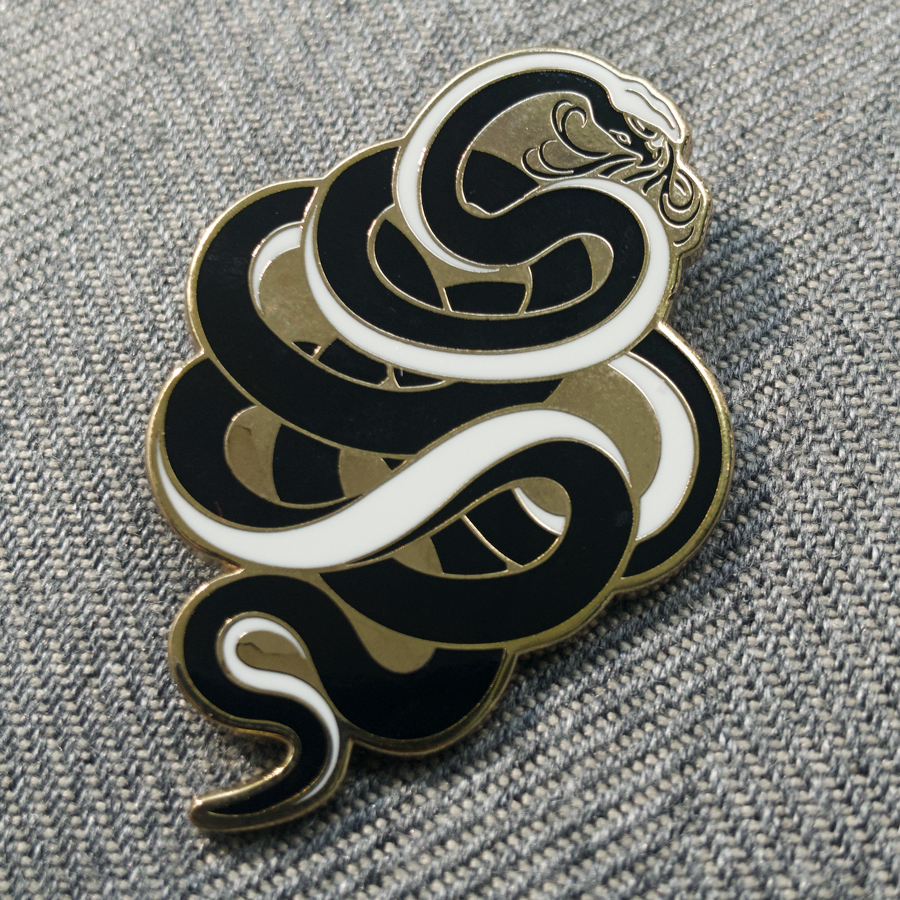 Python   Python was a serpent slain by the twins Artemis and Apollo. Design based on a sand viper, the only venomous snake native to Greece.