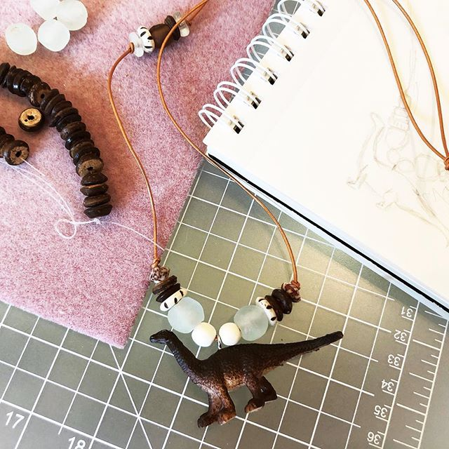 My son has been asking for a dinosaur necklace for a while and I've been working on prototyping potential designs. So, here we are: B's new necklace. Technically this fits a kid or an adult so you know, if you're over the age of 10 and still dig dinosaurs, there's a necklace for that. What do you think? . . . #handmadejewelry #bohojewelry #kidsjewelry #instastyle #makersgonnamake #designlife #artlife #artstagram #jewlerydesign #handmade #instajewelry #dinosaurs #dinosaur