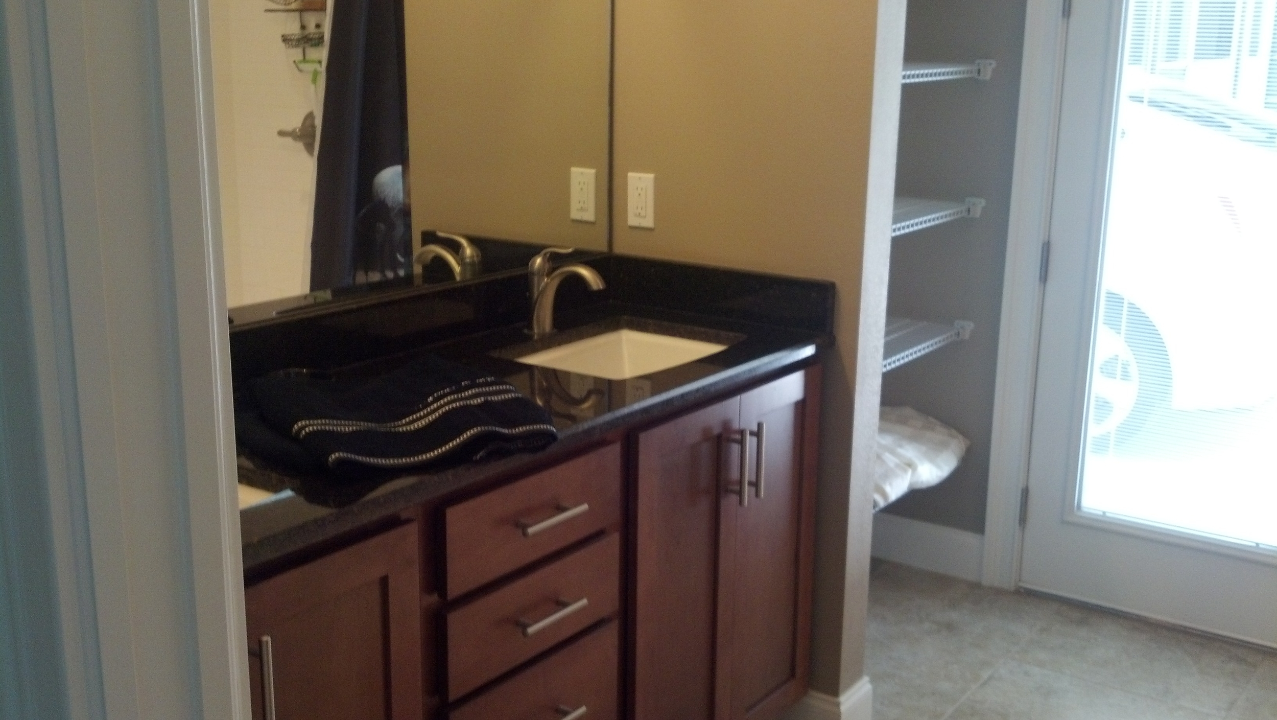 Guest bath with extra large shower, granite counter and dual vanities