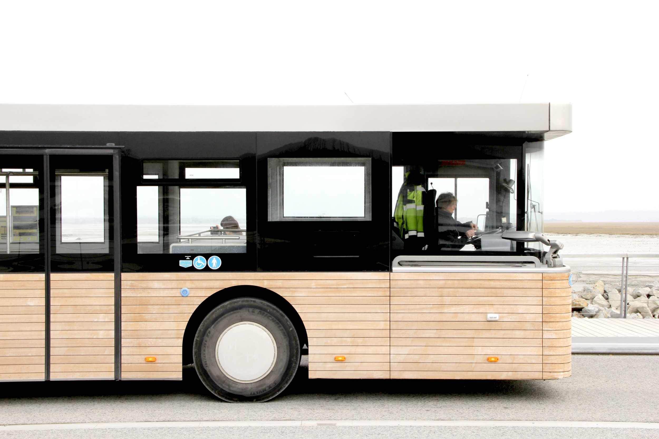Wood paneled buses at Le Mont St Michel