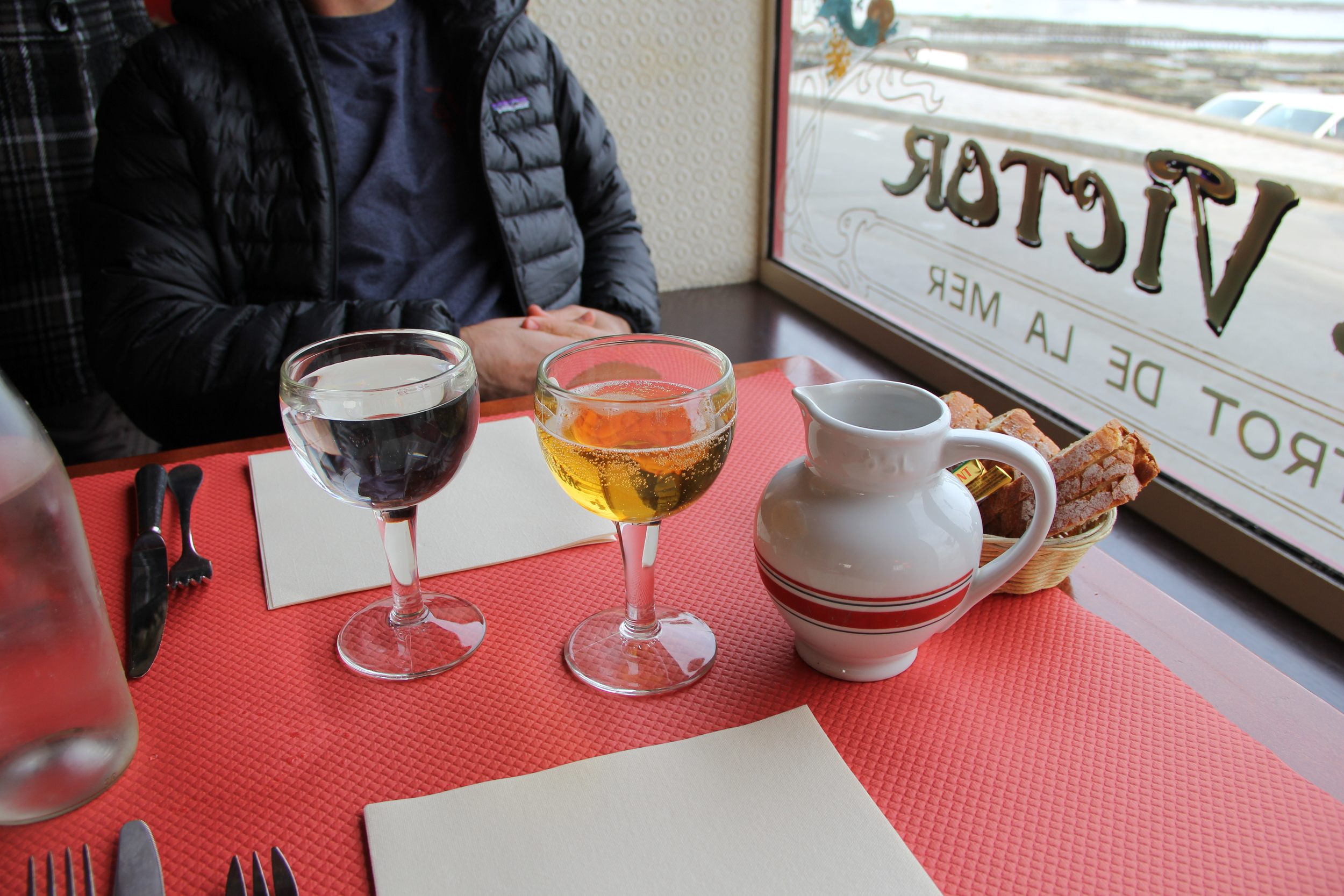 Local cidre poured straight from the tap at Cafe Victor in Cancale