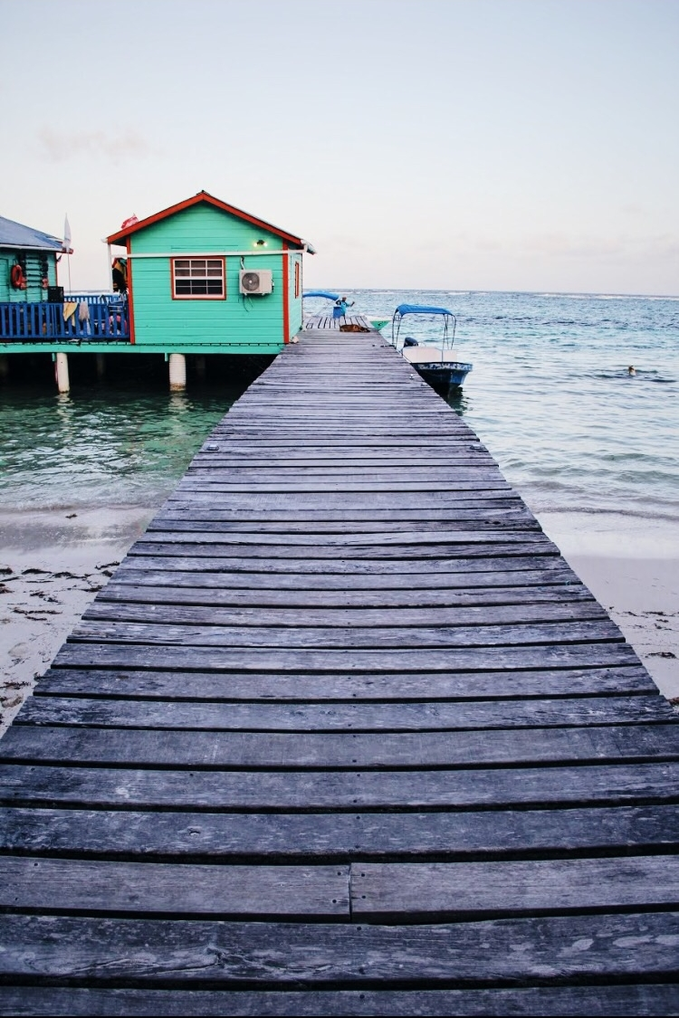 Travel Guide to Belize | turquoise buildings to match turquoise waters