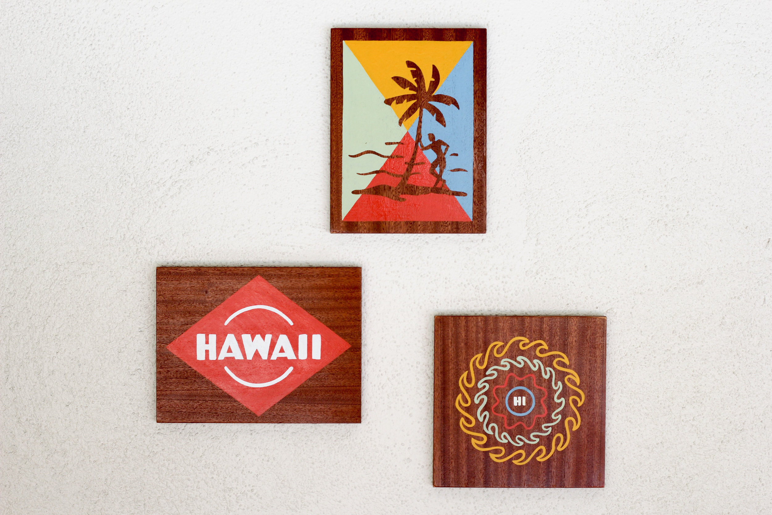 Local artists adorn the wall at the Surfjack in Honolulu
