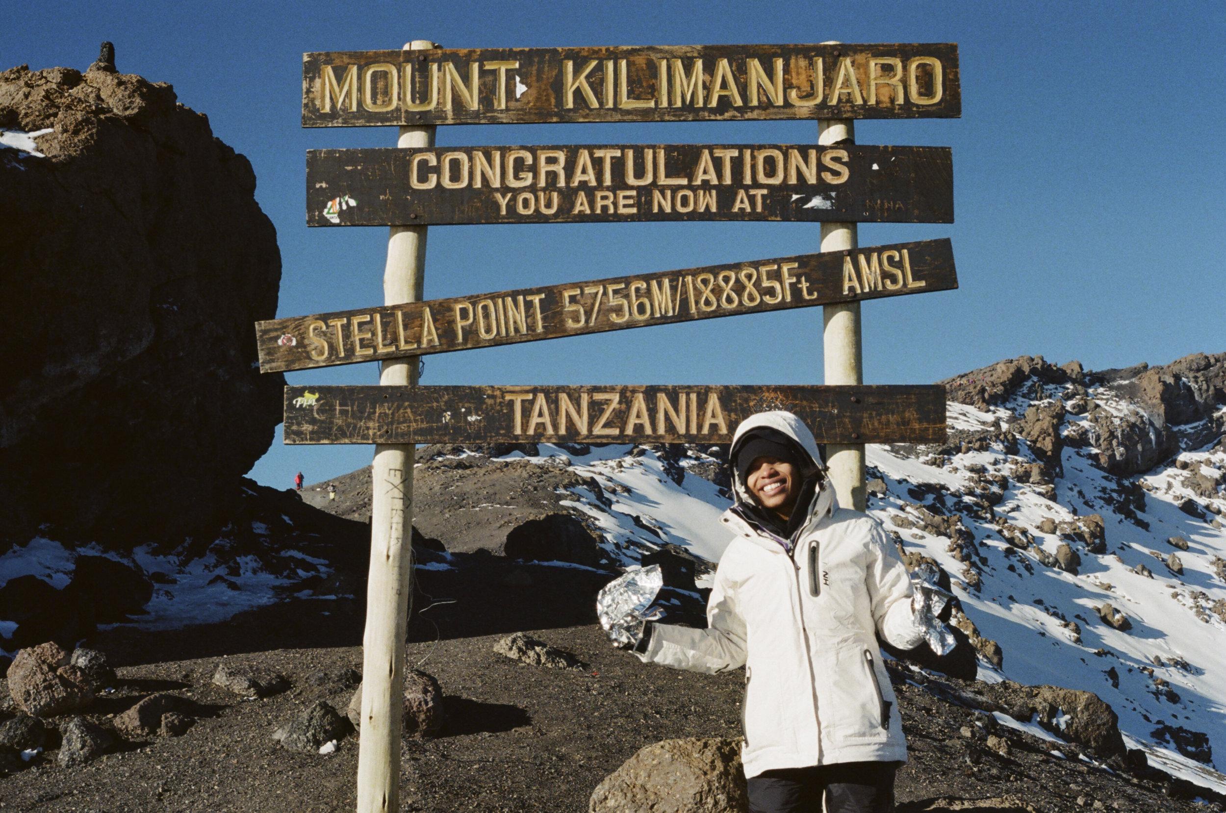 Nicole at the top of Mount Kilimanjaro