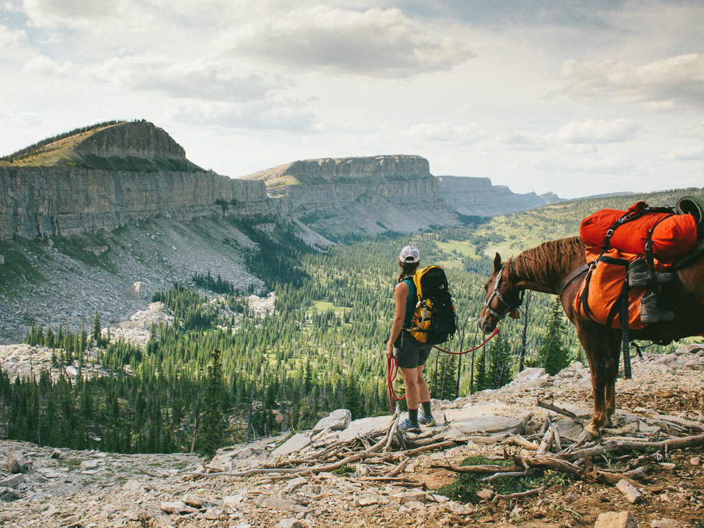 Mandy Mohler and Ben the Horse looking over the Chinese Wall, Bob Marshall Wilderness, Montana