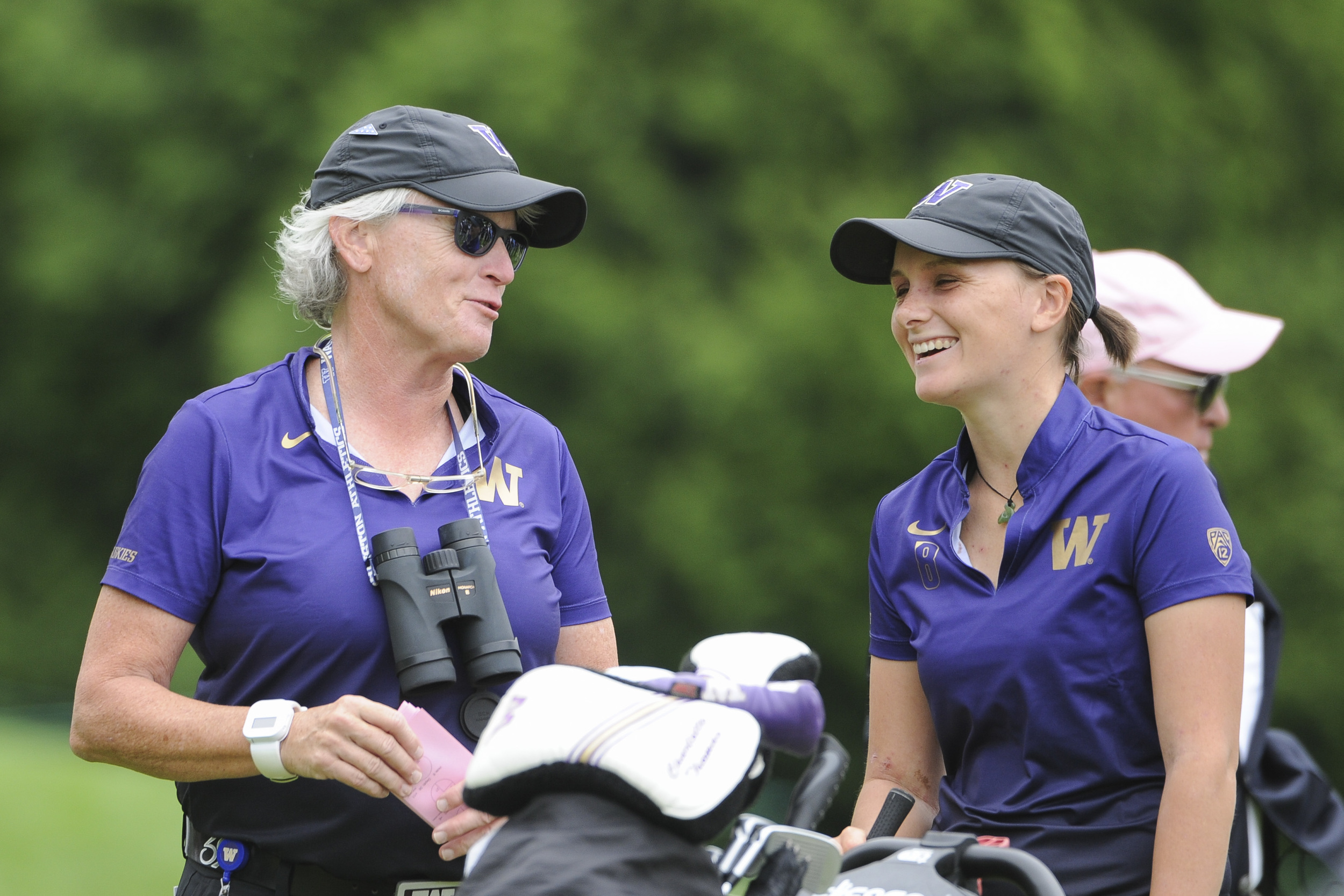 University of Washington's women's golf coach Mary Lou Mulflur (left) and one of her players, Englishwoman Charlotte Thomas, are all smiles after the university's win at the NCAA championship. Photo: University of Washington.