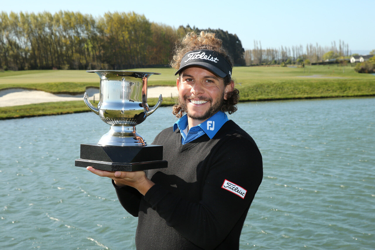 Tauranga golfer Luke Toomey with his trophy after winning the Pegasus Open in North Canterbury. Photo credit: New Zealand Golf.