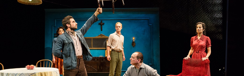 A View from the Bridge at the Alley Theater. Play by Arthur Miller; Directed by Greg Boyd; Scenic Design by Hugh Landwehr; Costume Design by Alejo Vietti, Sound Design by Michael Bodeen and Rob Milbern. Lighting Designer  Pictured from Left: Cara Ronzetti, Frank de Julio, Jay Sullivan, Mark Zeisler, Josie de Guzman. Photo by Alley Theater.