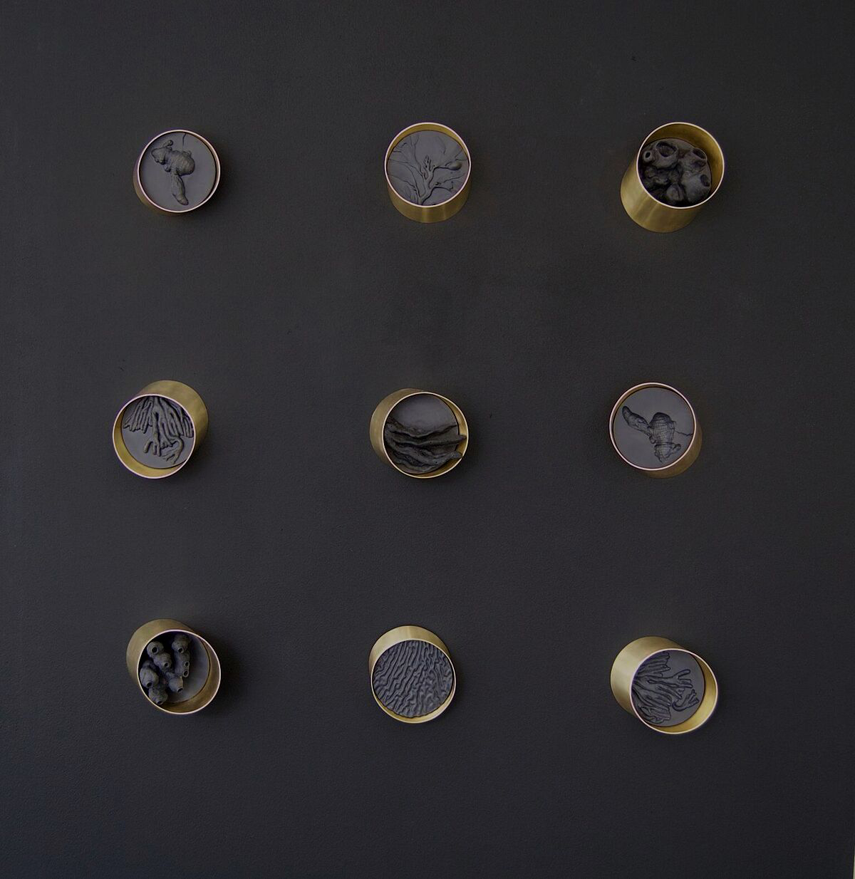 Jo Wilmot's  'oil slick black' porcelain and brass looked striking against a freshly painted black wall. Photograph courtesy of  Jo Wilmot.