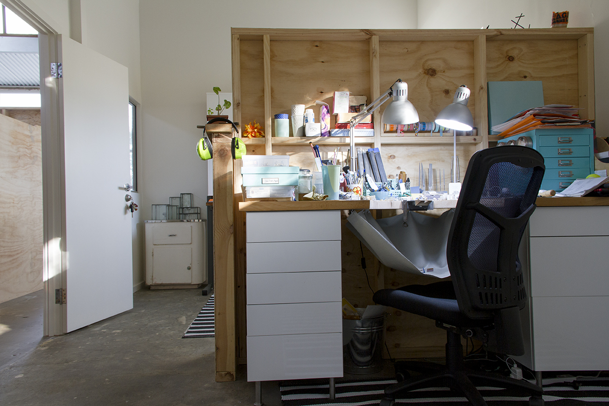 My workbench where all the magic (and madness) happens. The new studio space is divided into two halves by a ply wood wall. Photograph courtesy of  Bianca Hoffrichter.