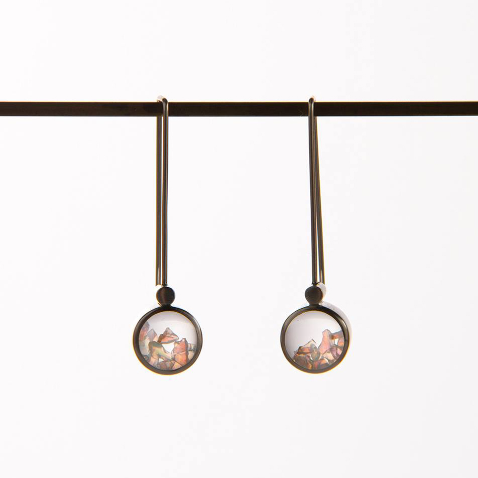 There are also a few pairs of Microscope Earrings left through the  campaign site . Avaialble in Andamooka Opal or Fresh Water Pearls which float freely behind glass lenses, these stunners are quite the eye catchers. Photograph courtesy of Bianca Hoffrichter.